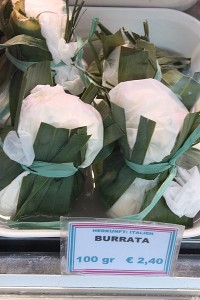 Burrata cheese wrapped in asphodel leaves. Wikimedia Commons via CC License.